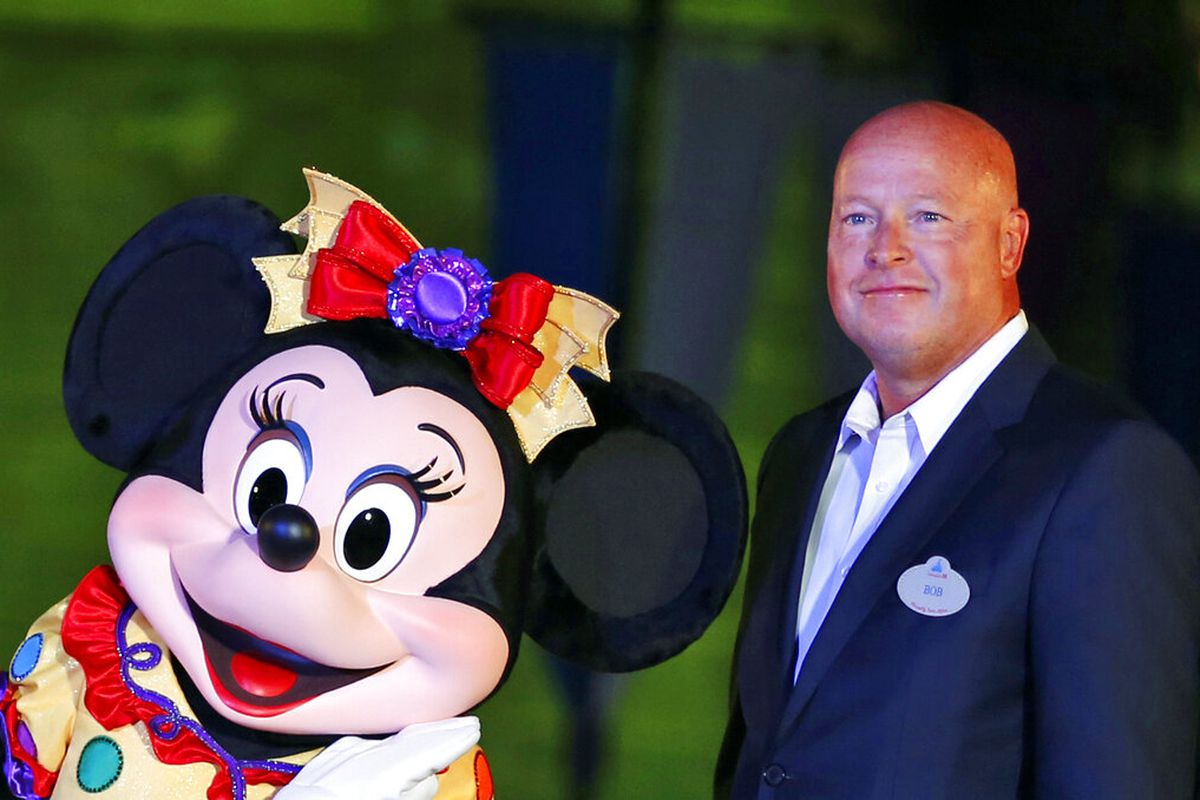 Chairman of Walt Disney Parks and Resorts Bob Chapek poses with Minnie Mouse during a ceremony at the Hong Kong Disneyland.