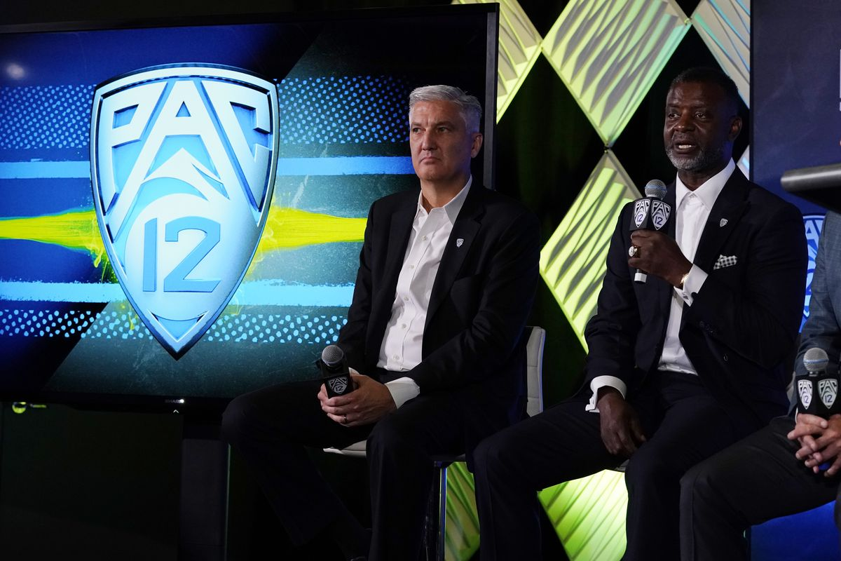 Pac-12 Commissioner George Kliavkoff, left, fields questions during Pac-12 football Media Day, July 27, 2021, in LA.