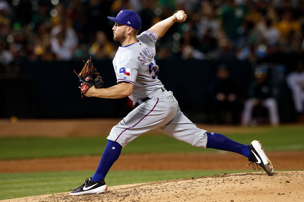 Adrian Sampson of the Texas Rangers pitches against the Oakland Athletics during the third inning at the RingCentral Coliseum on September 21, 2019 in Oakland, California. The Oakland Athletics defeated the Texas Rangers 12-3.