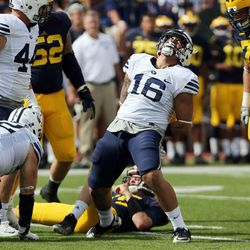 Sione Takitaki (16) of Brigham Young  celebrates when Jake Rudock (15) of the Michigan Wolverines is sacked during NCAA football in Ann Arbor, Michigan, Saturday, Sept. 26, 2015.