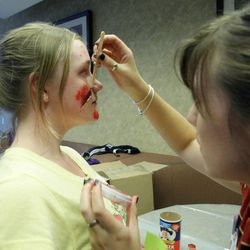 Jyllian Sanchez applies mock injuries to Samantha LeClair at Intermountain Medical Center during The Great Utah ShakeOut in Salt Lake County  Tuesday, April 17, 2012. This is the  largest earthquake drill ever conducted in Utah history.