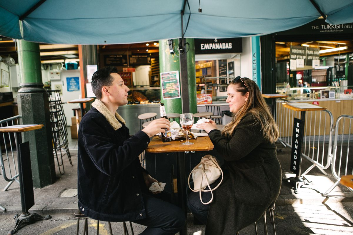 A couple having drinks at The Southwark Tavern in Borough Market