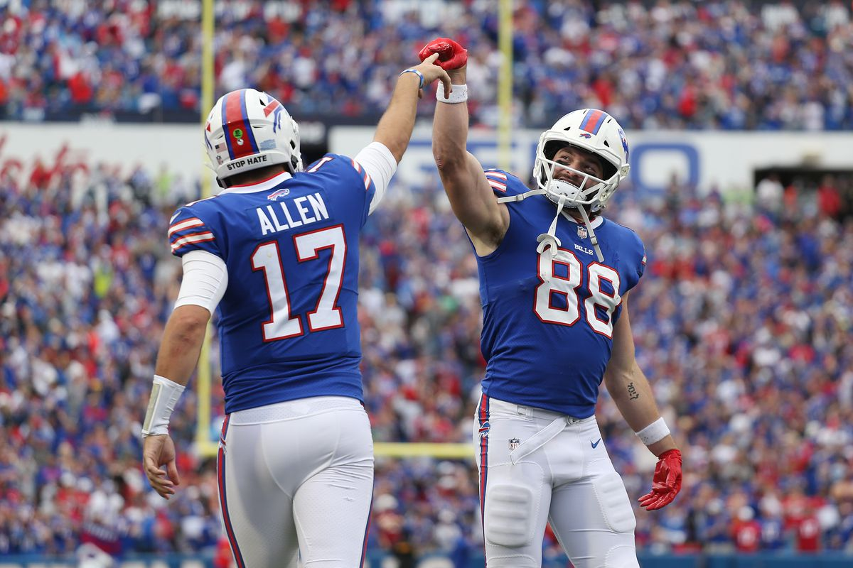 Quarterback Josh Allen and Dawson Knox of the Buffalo Bills celebrate after a rushing touchdown by Allen during the fourth quarter of the game against the Washington Football Team at Highmark Stadium on September 26, 2021 in Orchard Park, New York.