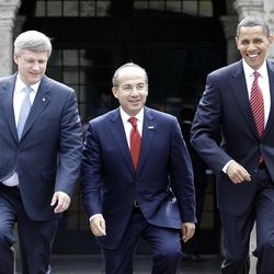 In this Aug. 10, 2009, file photo, President Barack Obama, right, Mexico's President Felipe Calderon, center, and Canada's Prime Minister Stephen Harper walk towards a stand for an official photo in Guadalajara, Mexico, for a North American summit.