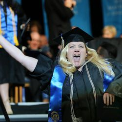 Brittany Peterson celebrates after receiving her degree during Salt Lake Community College's commencement at the Maverik Center in West Valley City on Friday, May 6, 2016.