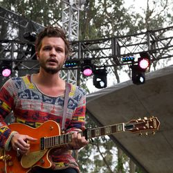Kristian Matsson, The Tallest Man on Earth, paired a pretty orange guitar with a multicolor sweater.