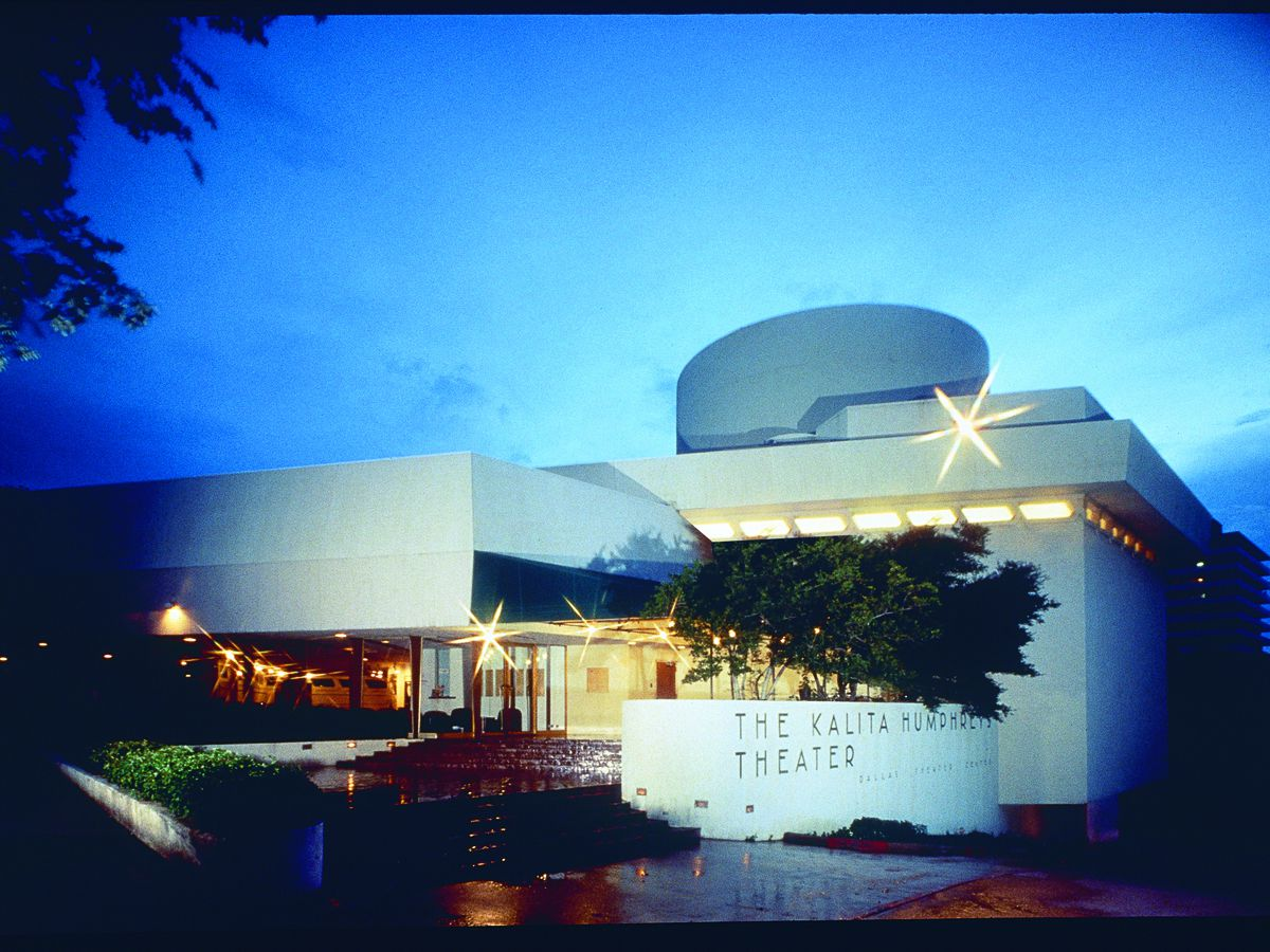 The exterior of Kalita Humphreys Theater in Texas. The building is white with an oval tower.