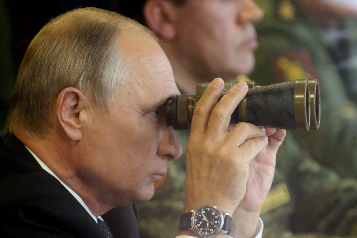Russian President Vladimir Putin watches a military exercise at a training ground at Luzhsky range near Saint Petersburg, Russia, on Sep. 18, 2017.
