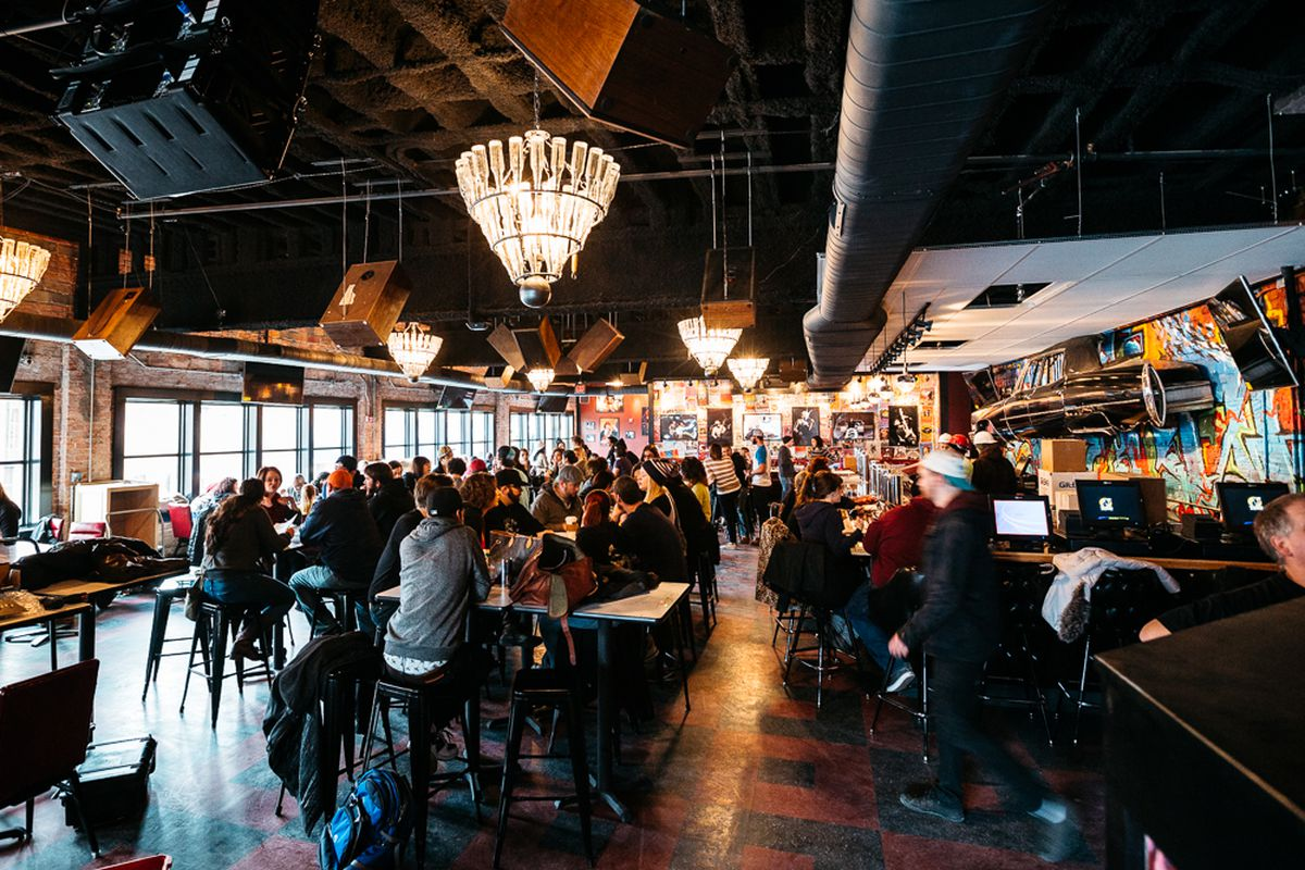 Customers gather inside the dining room at Hopcat Detroit.