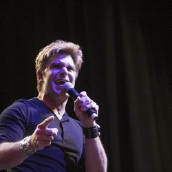 Vic Mignogna sings during the Salt Lake Comic Con kickoff news conference at the Salt Palace Convention Center in Salt Lake City, Thursday, Sept. 4, 2014.