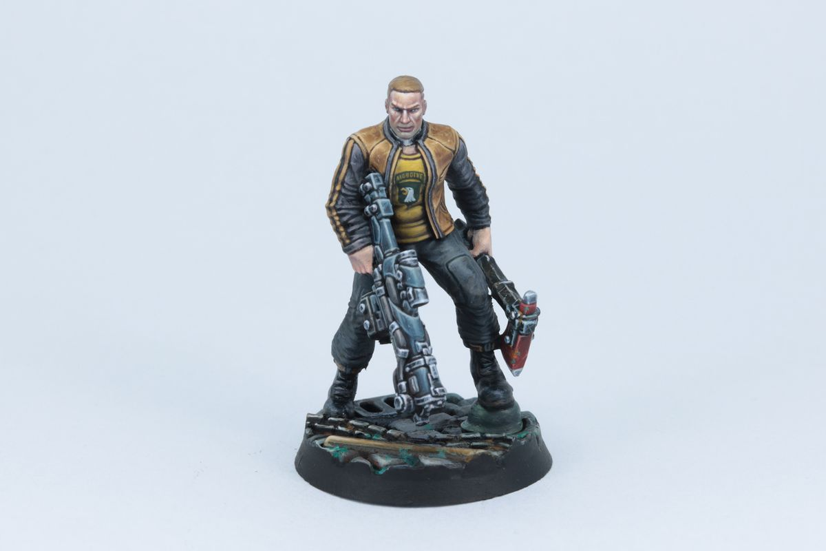 BJ miniature fully painted. He's holding an assault rifle and a melee axe.