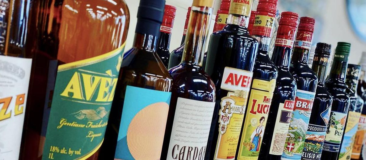 A shelf lined with bitter liquors