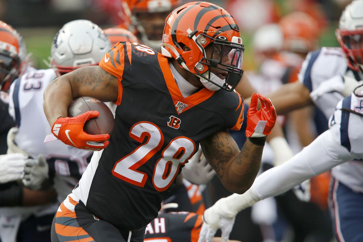Cincinnati Bengals running back Joe Mixon rushes for a first down run during the first quarter against the New England Patriots at Paul Brown Stadium