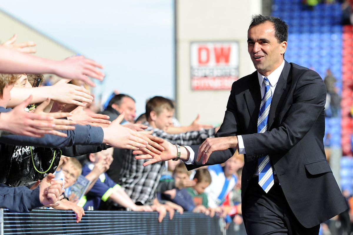Wigan Athletic manager Roberto Martinez shakes hands with the supporters following the Barclays Premier League match between Wigan Athletic and Wolverhampton Wanderers at DW Stadium.