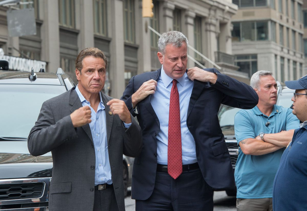 New York Governor Andrew Cuomo, left, and New York City Mayor Bill de Blasio arrive Sunday at the scene of an explosion on West 23rd Street in the Chelsea neighborhood in New York.| AFP PHOTO