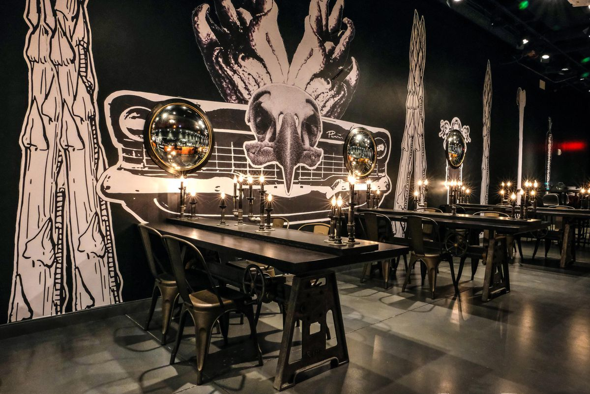 Tables in a black dining room