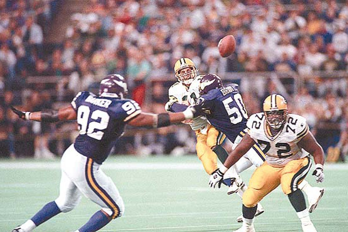 """Packers' quarterback Ty Detmer gets crushed by Minnesota linebacker Jeff Brady during the 1995 Packers/Vikings matchup at the Metrodome.  (Picture courtesy of <a href=""""http://www3.jsonline.com/packer/arc/image/vikingsb5/det.jpg"""">PackerNews</a>.)"""
