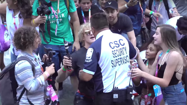 Logan Paul being held back by security as he's swarmed by fans at VidCon 2017