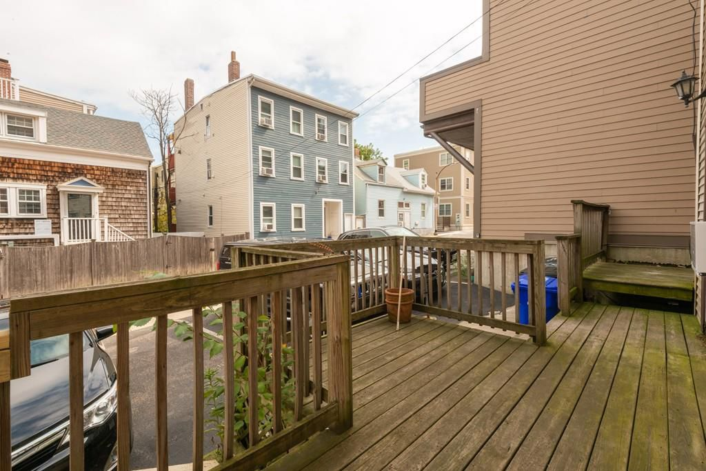 An older, sizable deck with part of it jutting out.