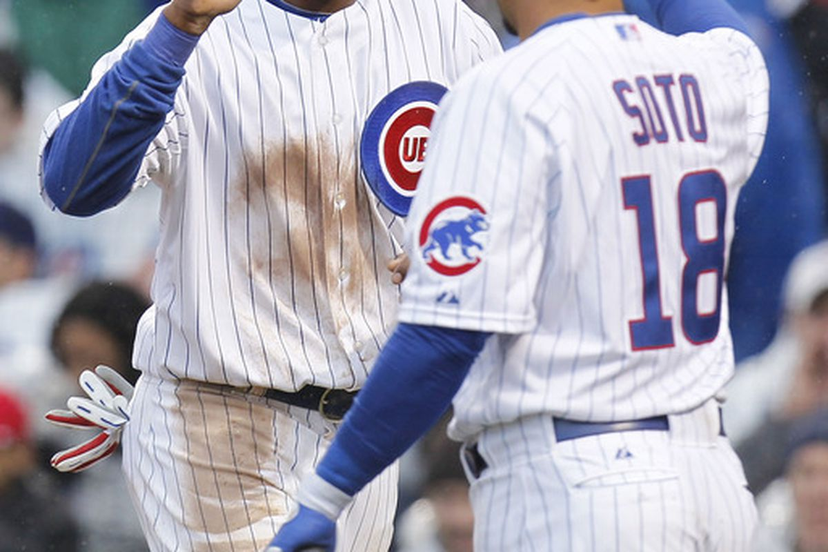 Starlin Castro of the Chicago Cubs high fives Geovany Soto after scoring in the third inning against the Pittsburgh Pirates during opening day at Wrigley Field in Chicago, Illinois.  (Photo by Gregory Shamus/Getty Images)