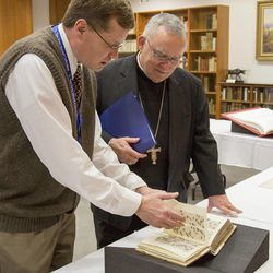 Gordon Daines takes Most Reverend Charles J. Chaput, Archbishop of Philadelphia, on a tour of the BYU special collections of Bibles during his visit to BYU on Jan. 23, 2015.