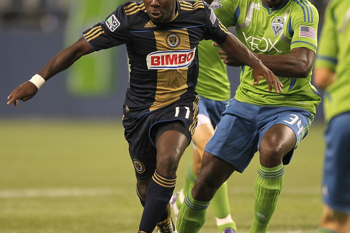SEATTLE - OCTOBER 08:  Freddy Adu #11 of the Philadelphia Union battles Jhon Kennedy Hurtado #34 of the Seattle Sounders FC at CenturyLink Field on October 8, 2011 in Seattle, Washington. (Photo by Otto Greule Jr/Getty Images)