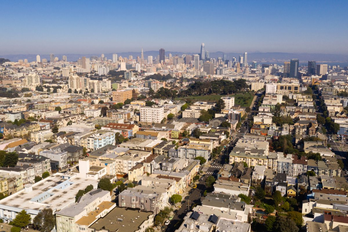 An aerial photo of San Francisco, with downtown in the background and residential homes in the foreground.