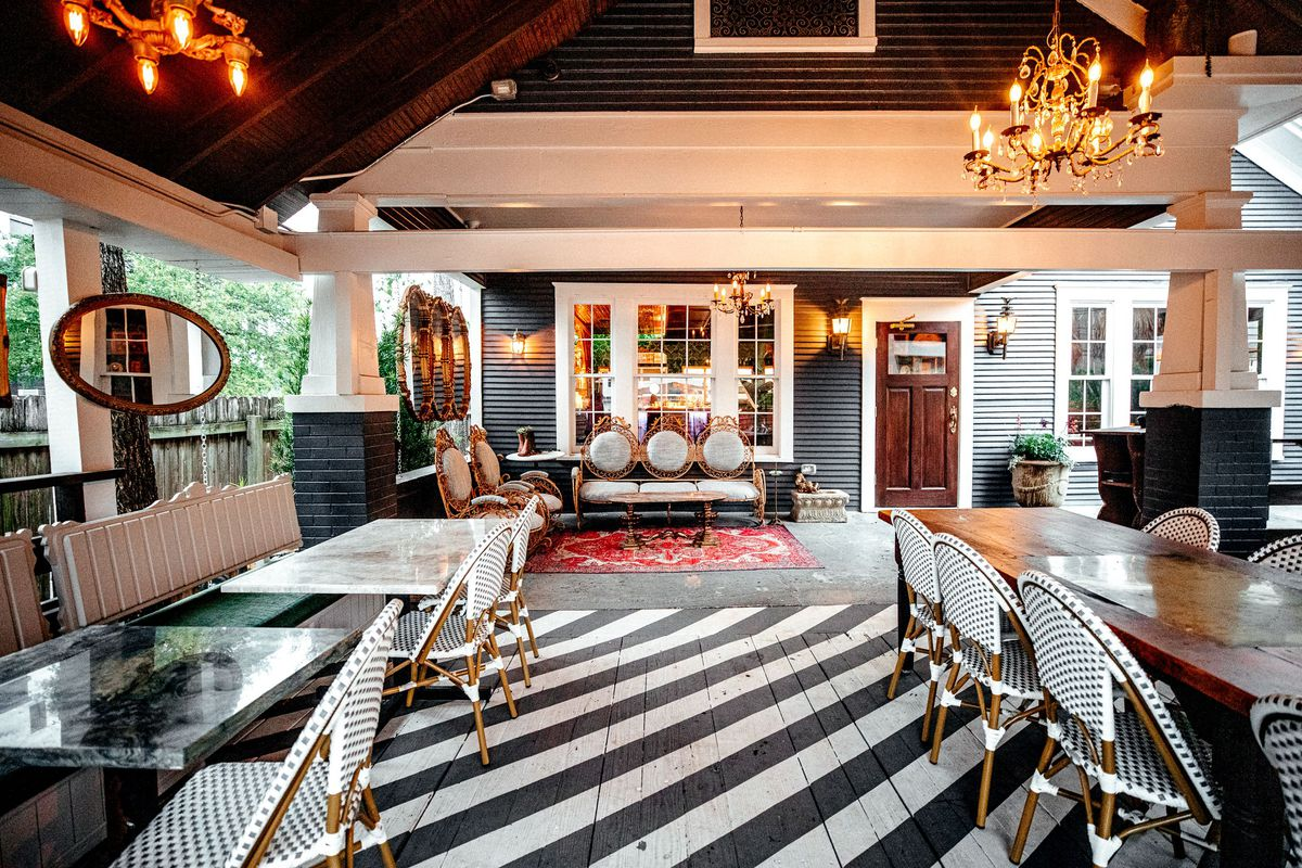 Black and white floor, black and white marble tables, those black and white French-style Article chairs everyone has