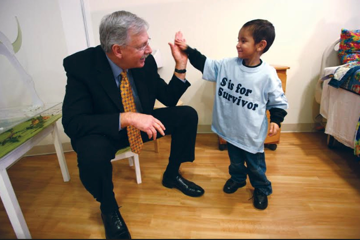 Patrick Magoon with a patient at Lurie Children's Hospital.