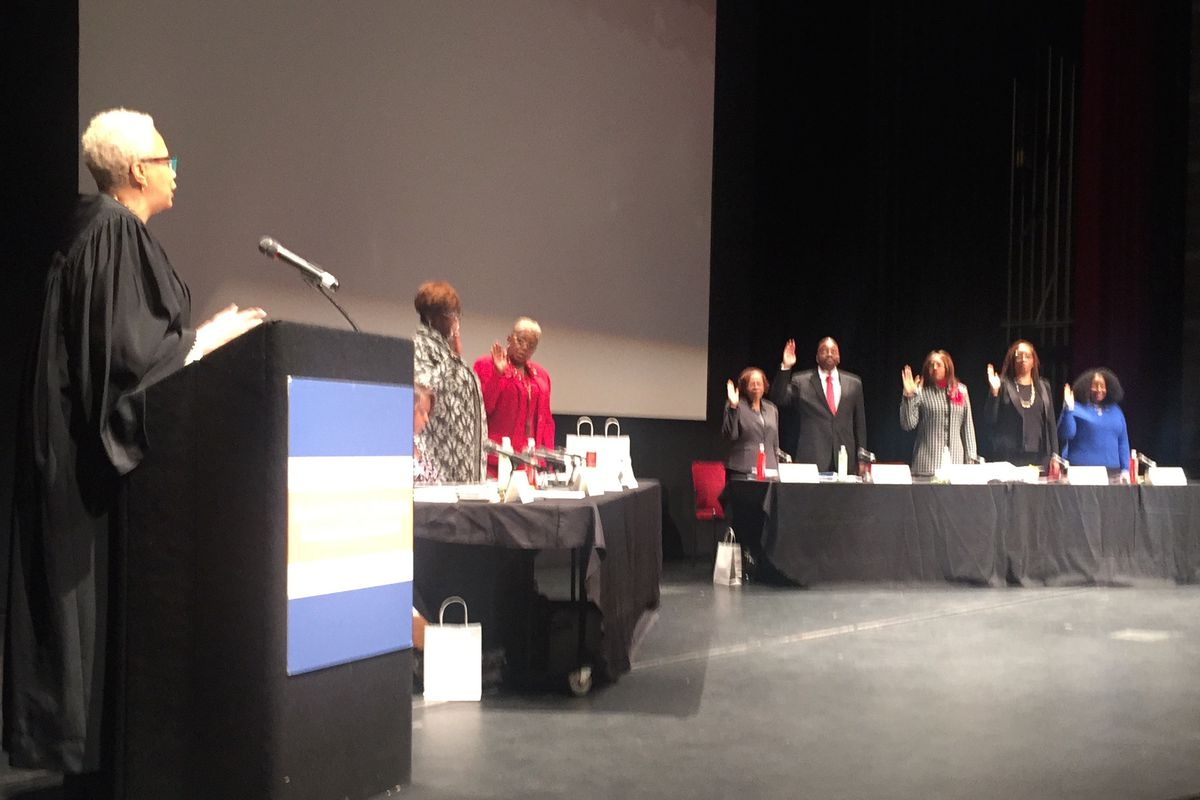 The seven members of the new Detroit school board were sworn in during their first meeting at Cass Tech high school.
