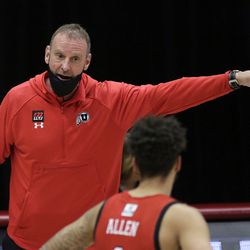Utah head coach Larry Krystkowiak, left, speaks with forward Timmy Allen during the second half of the team's NCAA college basketball game against Washington State in Pullman, Wash., Thursday, Jan. 21, 2021.