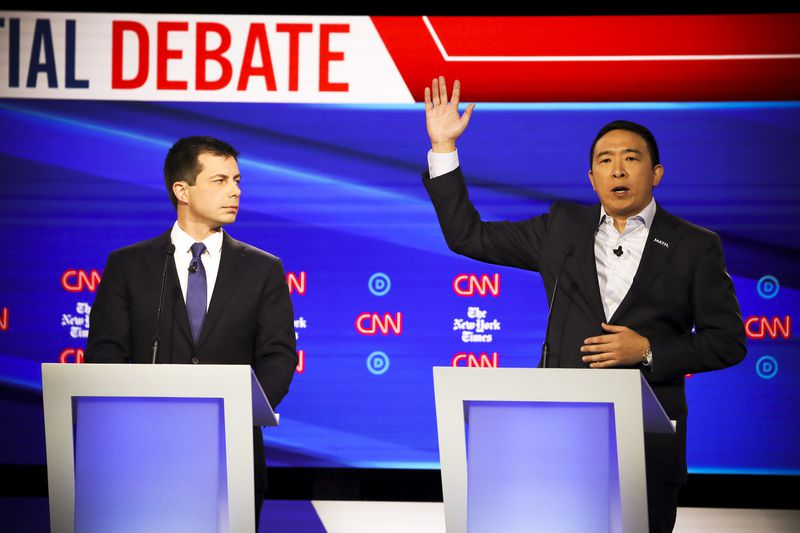 South Bend, Indiana Mayor Pete Buttigieg and former tech executive Andrew Yang on stage during the Democratic Presidential Debate.