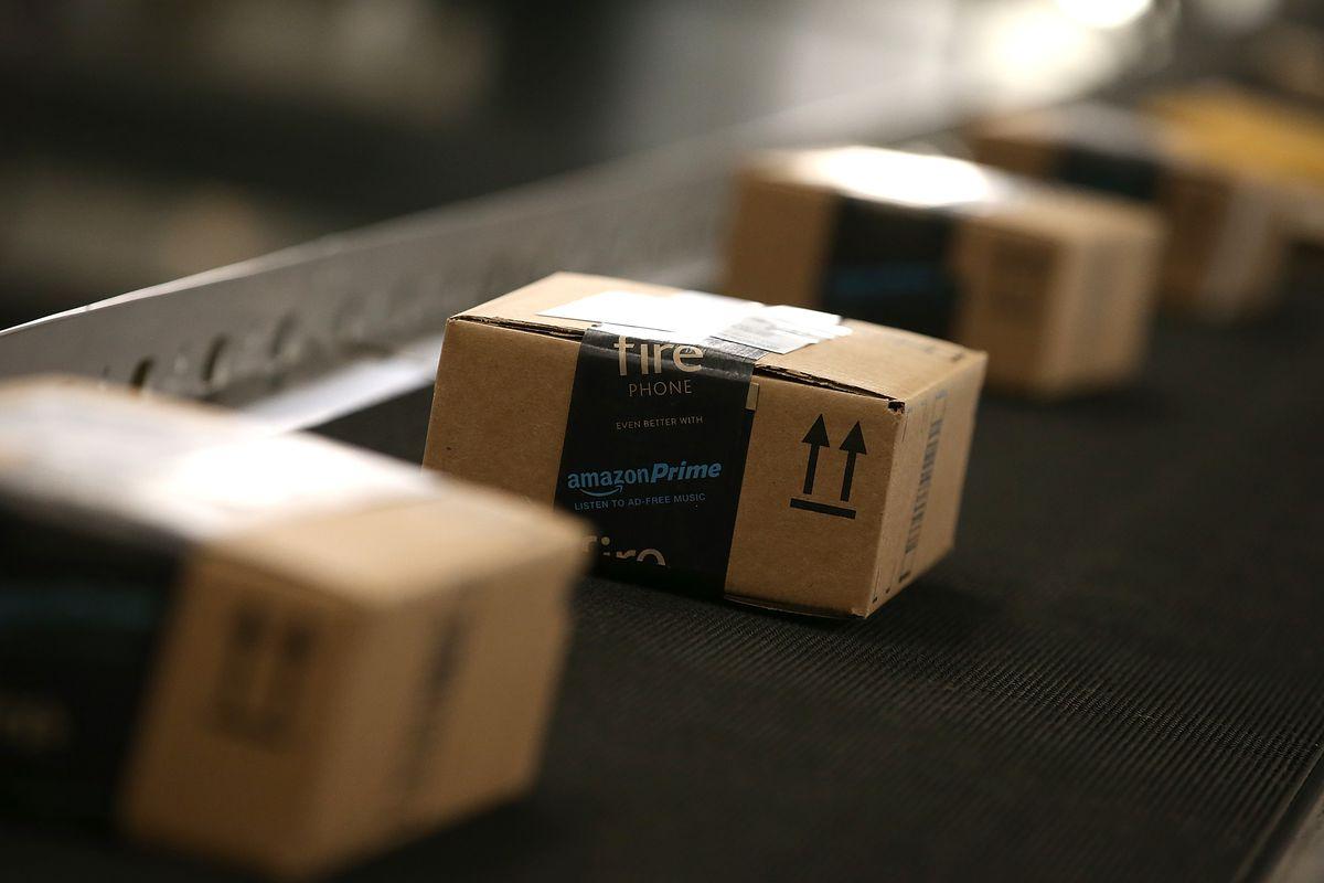 Amazon boxes on a conveyor belt.