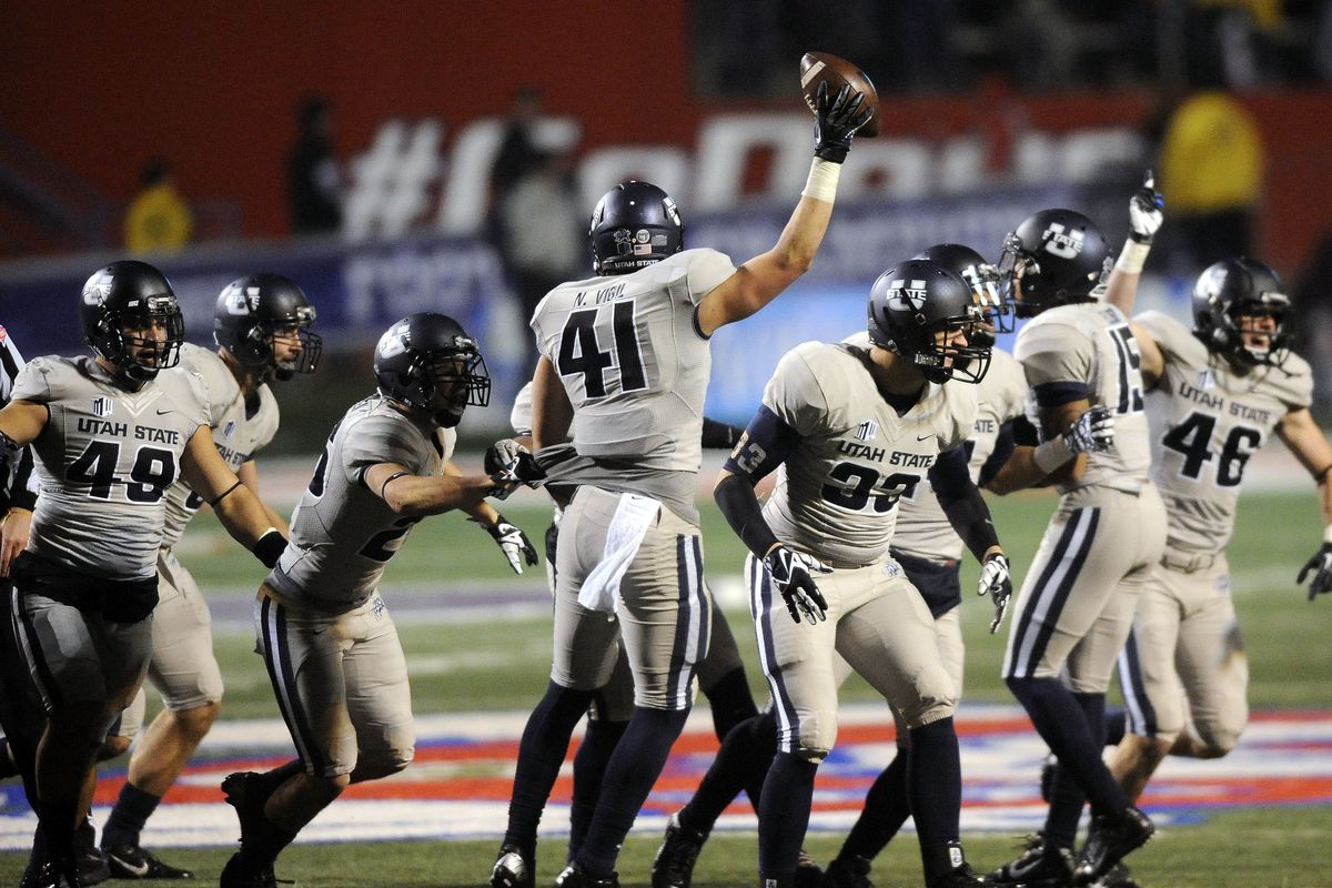 Utah State Aggies linebacker Nick Vigil (41) comes up with the football after an onside kick during the Mountain West Football Championship game at Bulldog Stadium in Fresno, Calif. on Saturday, December 7, 2013.