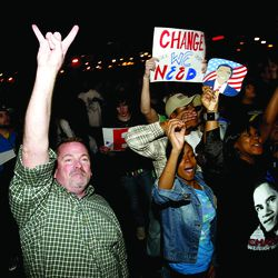 People cheer as vote projections are aired on CNN.