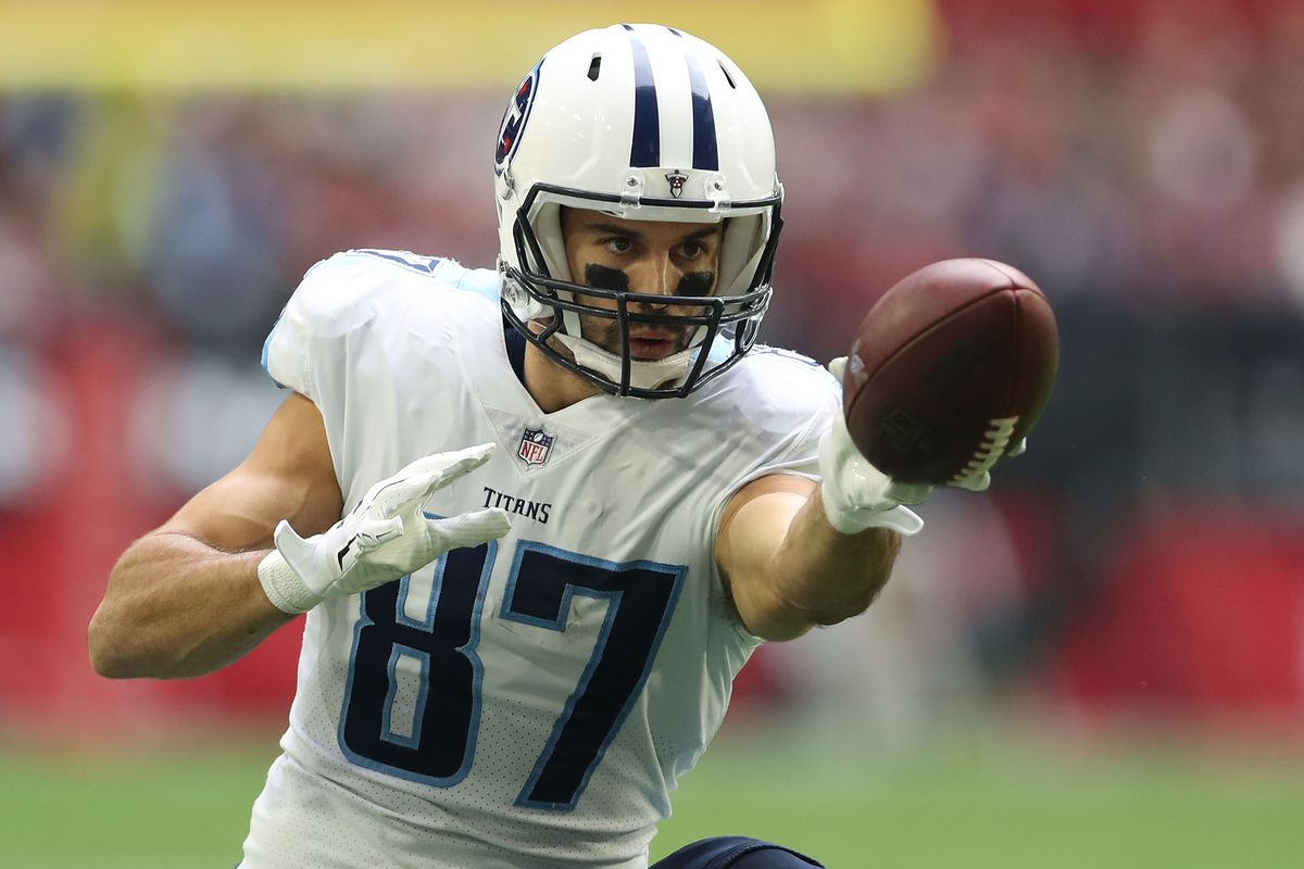 GLENDALE, AZ - Tennessee Titans wide receiver Eric Decker (87) extends for the first down marker after making a catch against the Arizona Cardinals defense at University of Phoenix Stadium.