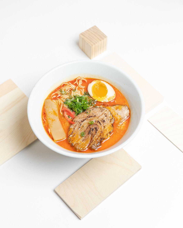 Creamy pork paitan broth with homemade chile oil chashu from Menya Hosaki