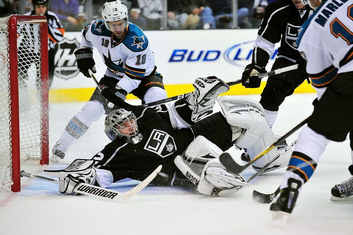 April 5, 2012; Los Angeles, CA, USA; Los Angeles Kings goalie Jonathan Quick (32) blocks a shot against the San Jose Sharks during the second period at Staples Center. Mandatory Credit: Gary A. Vasquez-US PRESSWIRE