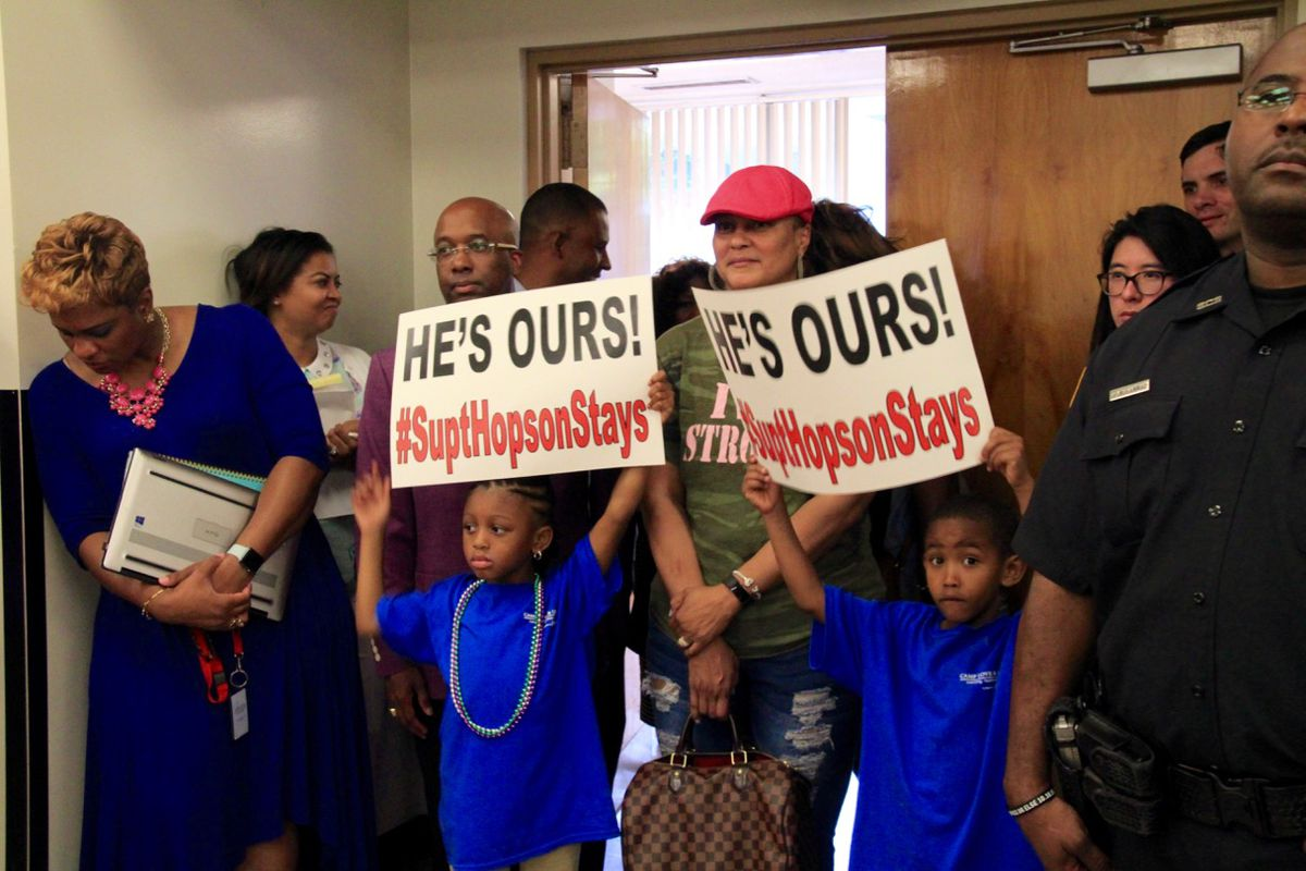Students hold signs in support of Superintendent Dorsey Hopson.