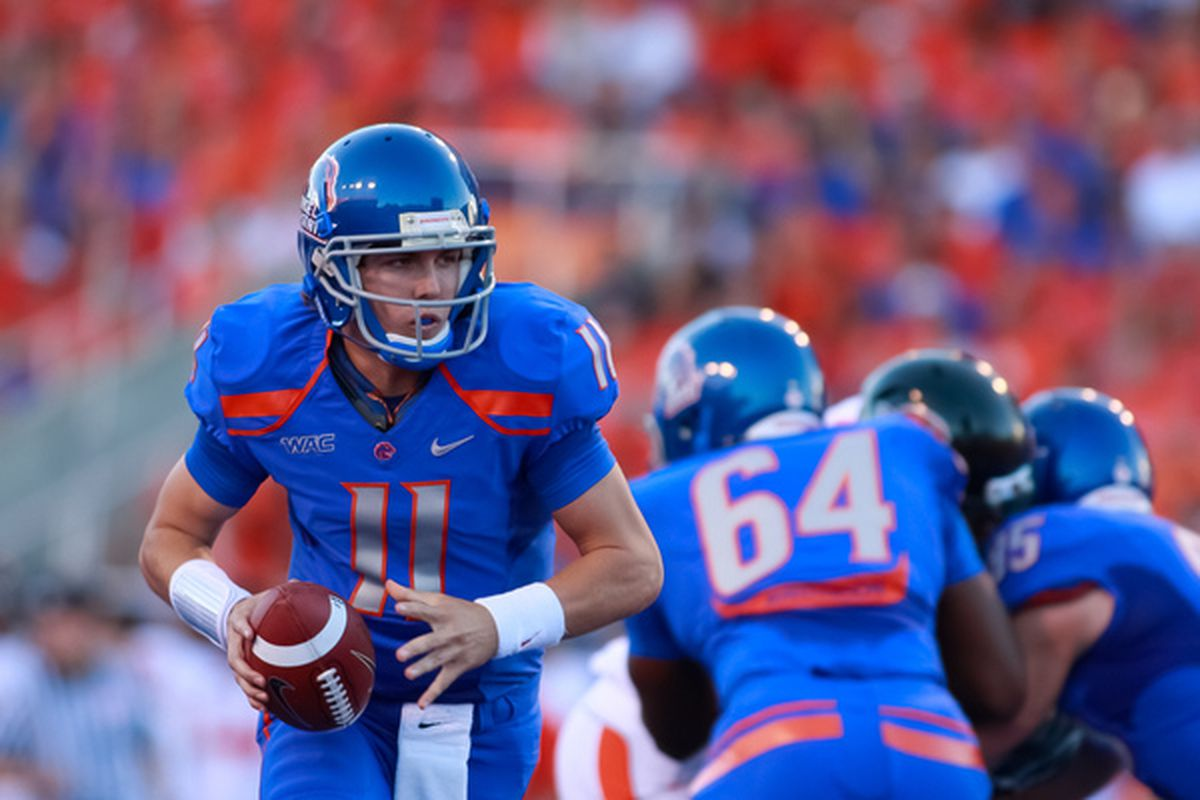 BOISE ID - SEPTEMBER 25:  Quarterback Kellen Moore #11 of the Boise State Broncos looks for a handoff against the Oregon State Beavers at Bronco Stadium on September 25 2010 in Boise Idaho.  (Photo by Otto Kitsinger III/Getty Images)
