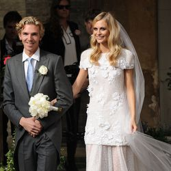 Seen posing with new husband James Cook on May 16th, 2014, Poppy Delevingne sported Chanel.