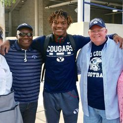 BYU's Dayan Ghanwoloku with his parents, Robert and Jenny, and his grandparents, Hans and Gayle Flink.