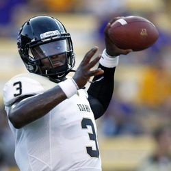 Idaho quarterback Dominique Blackman (3) warms up before before their NCAA college football game against LSU in Baton Rouge, Saturday, Sept. 15, 2012.