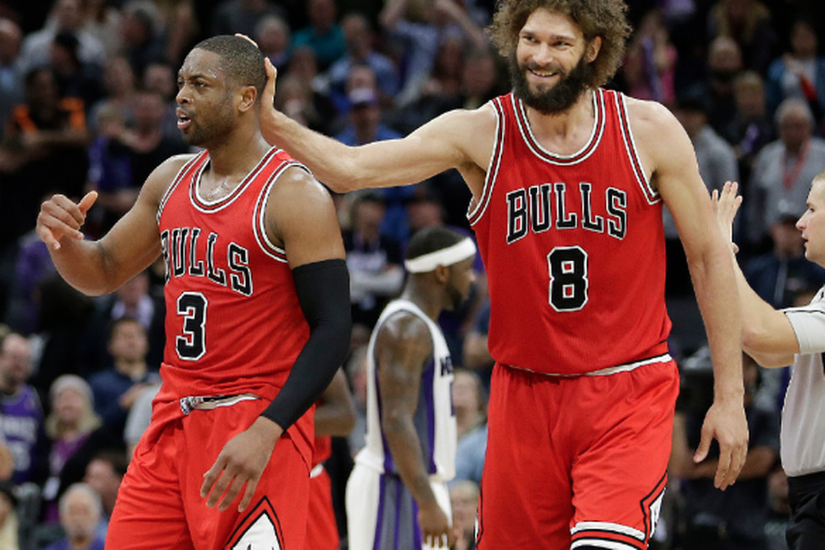 0b02459d8b0 Dwyane Wade is congratulated by Robin Lopez in the closing moments of the  Bulls  112-107 win over the Kings on Feb. 6