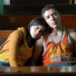 "Paulina Gaitan, left, and Edgar Flores star in writer/director Cary Joji Fukunaga's epic thriller ""Sin Nombre."""