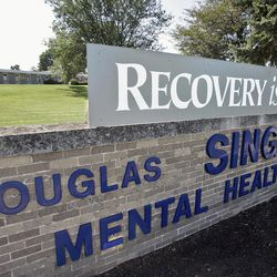 ADVANCE FOR USE MONDAY, APRIL 2 AND THEREAFTER - FILE - This Sept. 8, 2011 file photo shows the H. Douglas Singer Mental Health Center in Rockford, Ill. The center is one to be closed in proposed plans by Gov. Pat Quinn to phase out state institutions and lay off state employees. The facts behind the proposed plans are more complicated than recent harsh union ads acknowledge.