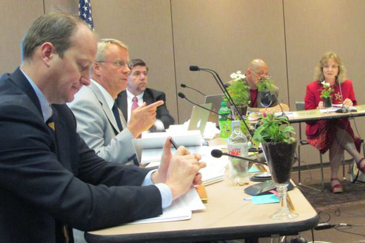 Gordon Henry (left) listens while Dan Elsener (second from the left) speaks at a state board meeting earlier this year. Brad Oliver, Troy Albert and Glenda Ritz look on.