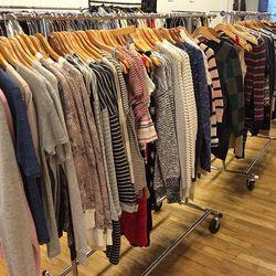 Racks of Cardigan sweaters