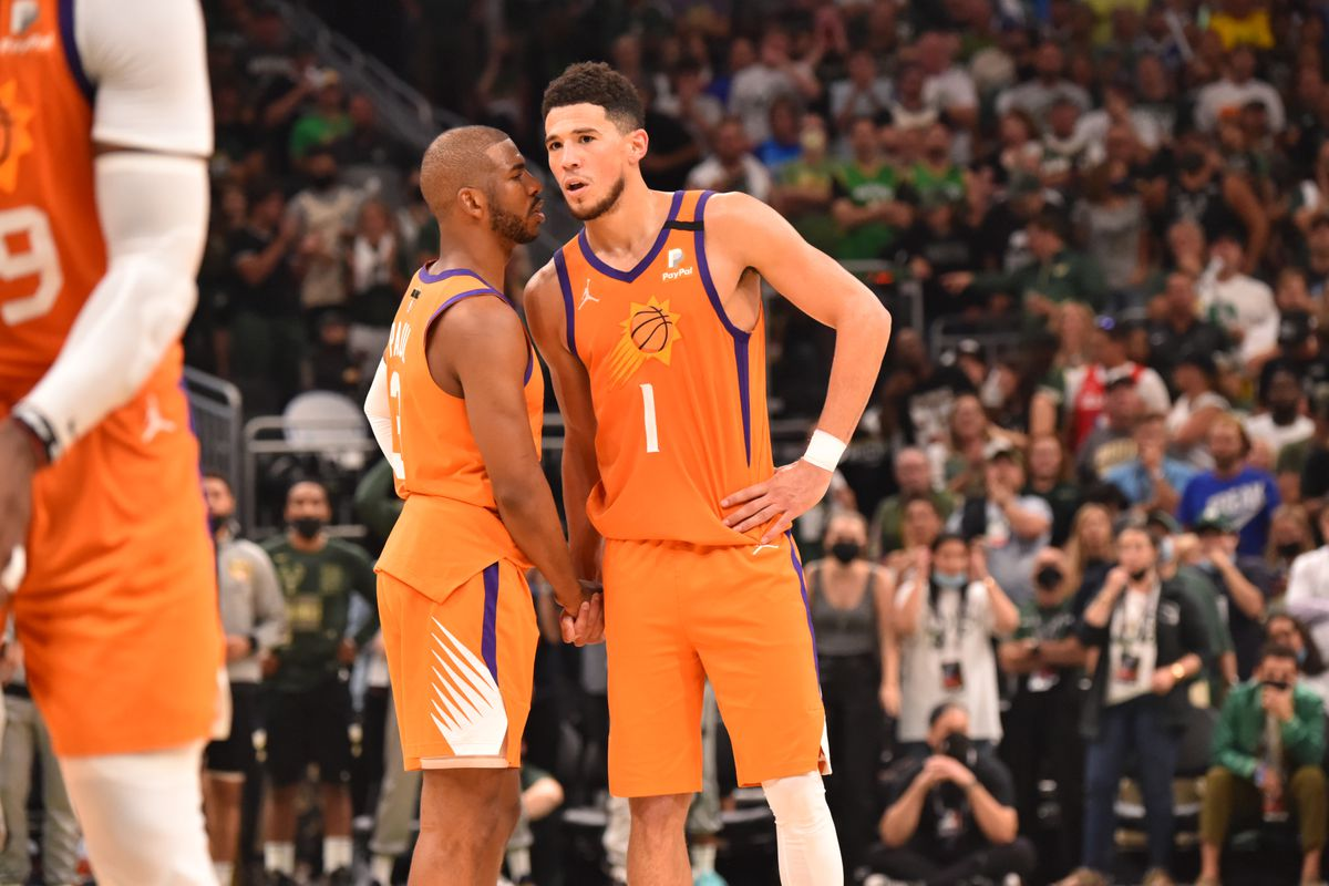 Chris Paul #3 of the Phoenix Suns and Devin Booker #1 of the Phoenix Suns talk during Game Six of the 2021 NBA Finals on July 20, 2021 at Fiserv Forum in Milwaukee, Wisconsin.