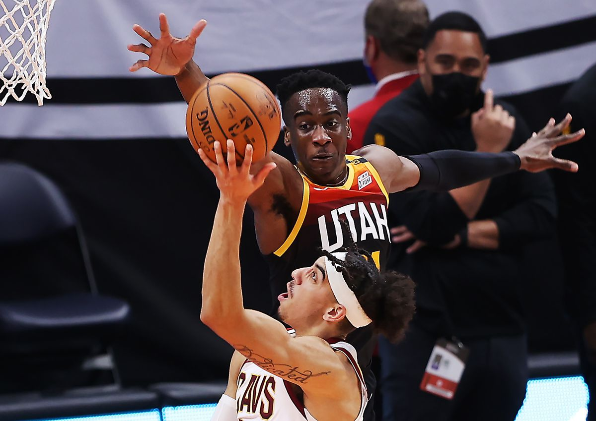 Utah Jazz goalie Miye Oni (81) defends Cleveland Cavaliers goalie Brodric Thomas (33) as the Utah Jazz and Cleveland Cavaliers play an NBA basketball game at Vivint Smart Home Arena in Salt Lake City on Monday, March 29, 2021. Utah won 114 -75.
